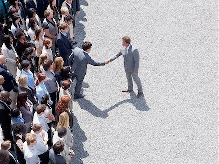partnership - Businessman shaking man's hand in crowd Stock Photo - Premium Royalty-Free, Code: 635-06191706
