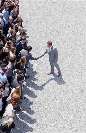 Businessman shaking man's hand in crowd Stock Photo - Premium Royalty-Free, Code: 635-06191709