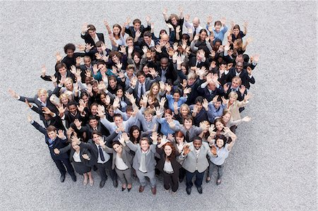 Portrait of waving business people Stock Photo - Premium Royalty-Free, Code: 635-06191701