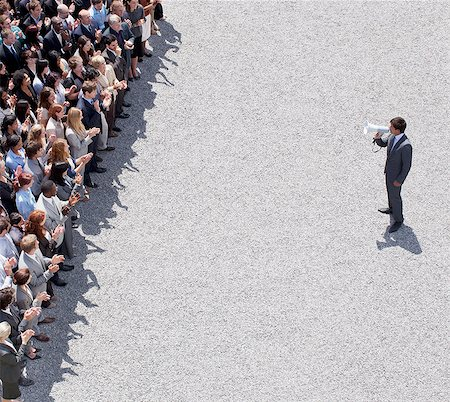 Businessman with bullhorn talking to crowd of people Stock Photo - Premium Royalty-Free, Code: 635-06191702
