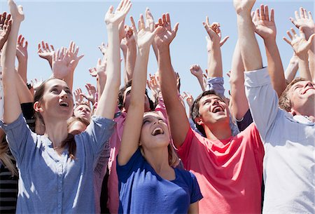 Cheering crowd with arms raised Stock Photo - Premium Royalty-Free, Code: 635-06191714