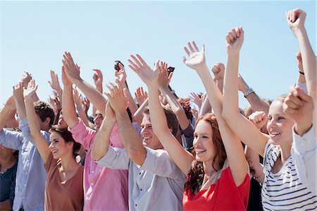 Cheering crowd with arms raised Stock Photo - Premium Royalty-Free, Code: 635-06191710