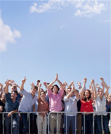 Cheering crowd with arms raised Stock Photo - Premium Royalty-Free, Code: 635-06191724