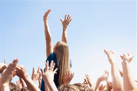 Woman with arms raised above crowd Stock Photo - Premium Royalty-Free, Code: 635-06191720