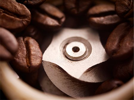 Close up of coffee beans in grinder Stock Photo - Premium Royalty-Free, Code: 635-06191735