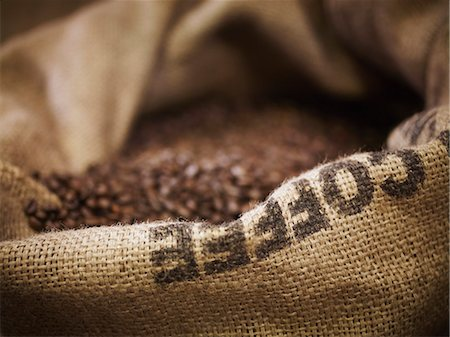 Close up of burlap sack with coffee beans Stock Photo - Premium Royalty-Free, Code: 635-06191754