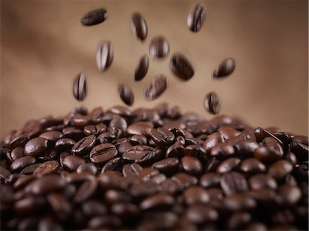 Close up of coffee beans falling in heap Stock Photo - Premium Royalty-Free, Code: 635-06191760