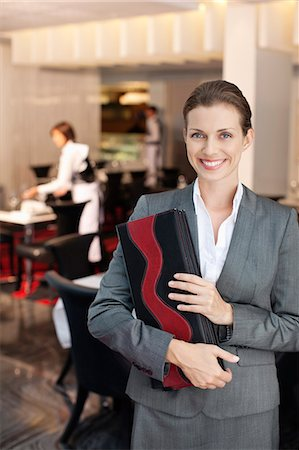 Portrait of smiling hostess in restaurant Stock Photo - Premium Royalty-Free, Code: 635-06192036