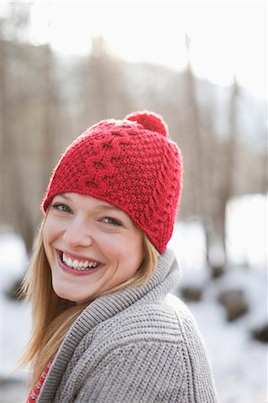 Close up portrait of smiling woman with red knit hat Stock Photo - Premium Royalty-Free, Code: 635-06192158