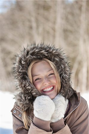 fur - Portrait of smiling woman wearing fur hood coat Stock Photo - Premium Royalty-Free, Code: 635-06192164
