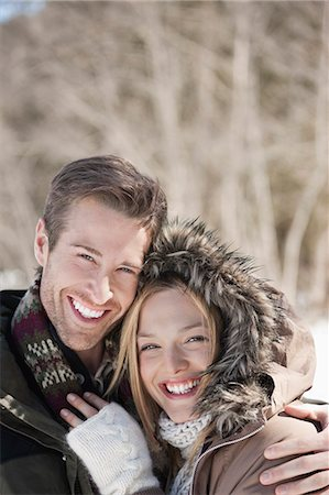 Portrait of smiling couple hugging outdoors Stock Photo - Premium Royalty-Free, Code: 635-06192168