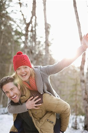 funky - Portrait of smiling couple piggybacking in snow Stock Photo - Premium Royalty-Free, Code: 635-06192162