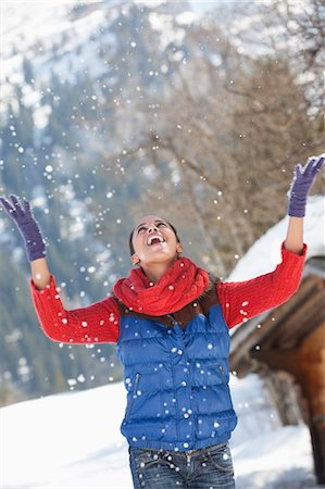snowflakes  holiday - Happy woman throwing snow and looking up Stock Photo - Premium Royalty-Free, Code: 635-06192173