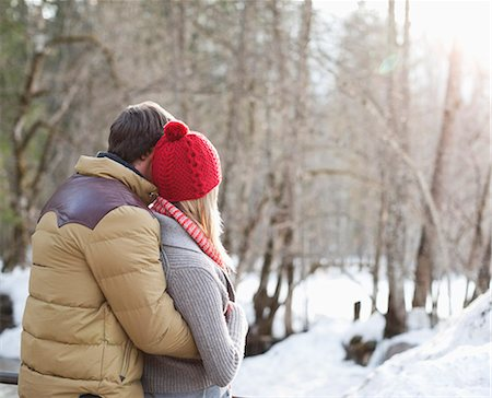funky - Couple hugging in snowy woods Stock Photo - Premium Royalty-Free, Code: 635-06192183