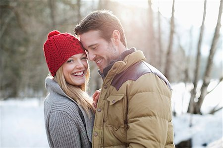 Portrait of smiling couple in snowy woods Stock Photo - Premium Royalty-Free, Code: 635-06192209