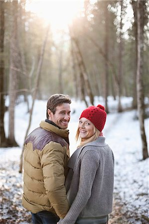 funky - Portrait of smiling couple holding hands in snowy woods Stock Photo - Premium Royalty-Free, Code: 635-06192223