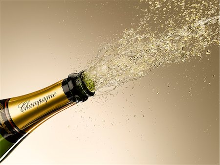 Champagne exploding from bottle Stock Photo - Premium Royalty-Free, Code: 635-06192309