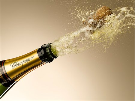 Champagne and cork exploding from bottle Stock Photo - Premium Royalty-Free, Code: 635-06192310