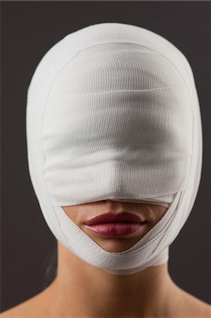 Close up of woman with bandaged face Stock Photo - Premium Royalty-Free, Code: 635-07364057