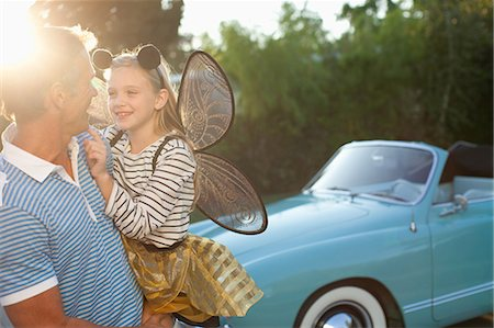 dress up girl - Father holding daughter in fairy wings Stock Photo - Premium Royalty-Free, Code: 635-07364217