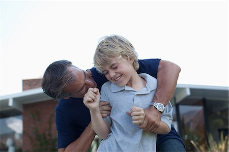 Father and son playing outdoors Stock Photo - Premium Royalty-Free, Code: 635-07364210