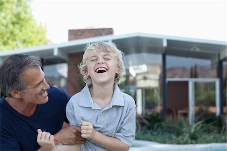 Father and son playing outdoors Stock Photo - Premium Royalty-Free, Code: 635-07364211