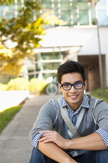 Student smiling outdoors Stock Photo - Premium Royalty-Free, Image code: 635-07364405
