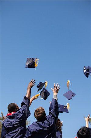 Graduates throwing caps in air outdoors Stock Photo - Premium Royalty-Free, Code: 635-07364426