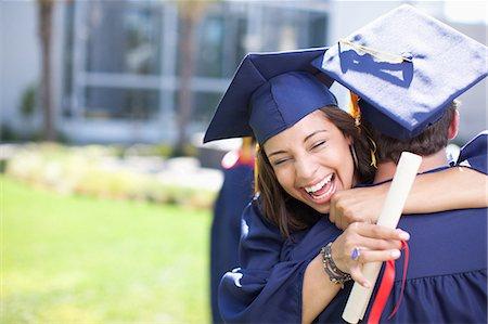 Graduates hugging Stock Photo - Premium Royalty-Free, Code: 635-07364537