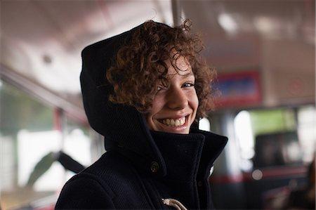 Smiling woman riding bus Stock Photo - Premium Royalty-Free, Code: 635-07364725