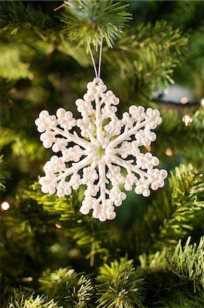 Snowflake Christmas ornament on tree Stock Photo - Premium Royalty-Free, Code: 635-07364803