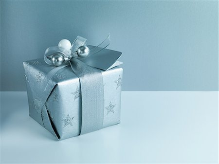 Christmas gift with silver ribbon and wrapping Stock Photo - Premium Royalty-Free, Code: 635-07364834