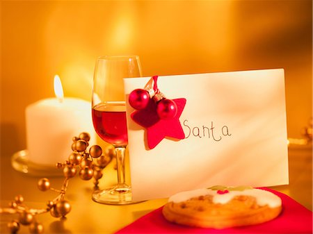 present wrapped close up - Cookie, wine and card for Santa Stock Photo - Premium Royalty-Free, Code: 635-07364833