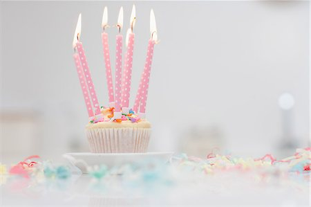 Birthday candles on cupcake Stock Photo - Premium Royalty-Free, Code: 635-07364880