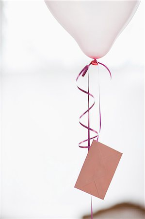string - Balloon with card attached to string Stock Photo - Premium Royalty-Free, Code: 635-07364930