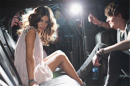 rich lifestyle - Celebrities emerging from car towards paparazzi Stock Photo - Premium Royalty-Free, Code: 635-07365045