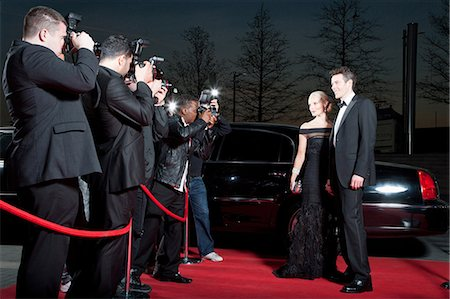 Celebrities posing for paparazzi on red carpet Stock Photo - Premium Royalty-Free, Code: 635-07365061