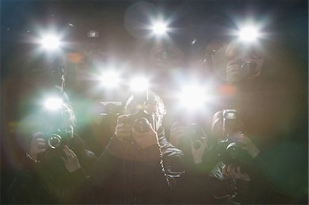 Paparazzi taking pictures with flash Stock Photo - Premium Royalty-Free, Code: 635-07365062