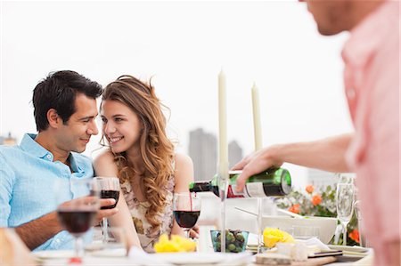Couples enjoying party on balcony Stock Photo - Premium Royalty-Free, Code: 635-07365361