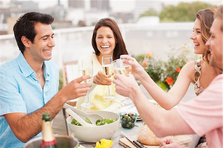 Laughing couples toasting with Champagne outdoors Stock Photo - Premium Royalty-Free, Code: 635-07365363