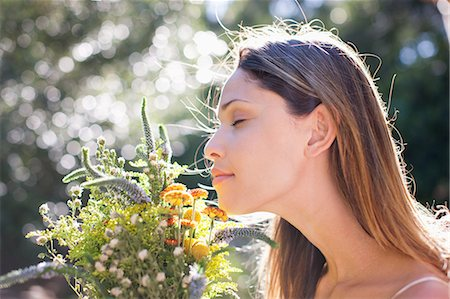 smelling - Serene woman smelling bouquet Stock Photo - Premium Royalty-Free, Code: 635-07365550