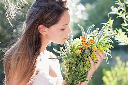 smelling - Woman holding bouquet of flowers Stock Photo - Premium Royalty-Free, Code: 635-07365551