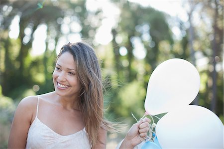 smelling - Smiling woman with  balloons Stock Photo - Premium Royalty-Free, Code: 635-07365552