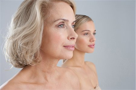 Close up of bare chested mother and daughter Stock Photo - Premium Royalty-Free, Code: 635-07456518