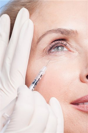 Close up of woman receiving botox injection under eye Stock Photo - Premium Royalty-Free, Code: 635-07456528