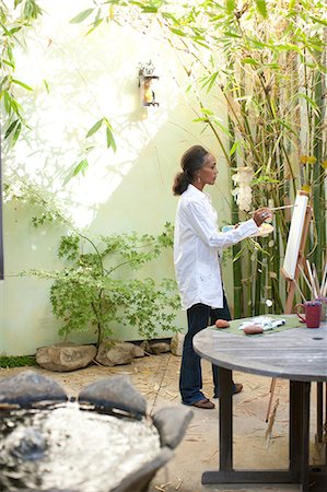painter - Woman painting on patio Stock Photo - Premium Royalty-Free, Code: 635-07456894