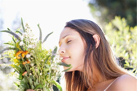 smelling - Serene woman smelling bouquet Stock Photo - Premium Royalty-Free, Code: 635-07456986