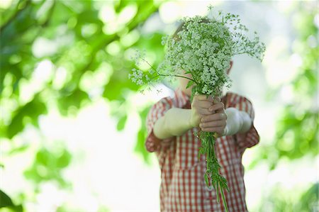 Boy offering bouquet of flowers Stock Photo - Premium Royalty-Free, Code: 635-07494803