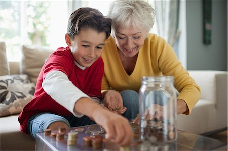 Grandmother and grandson counting coins Stock Photo - Premium Royalty-Free, Code: 635-07494925
