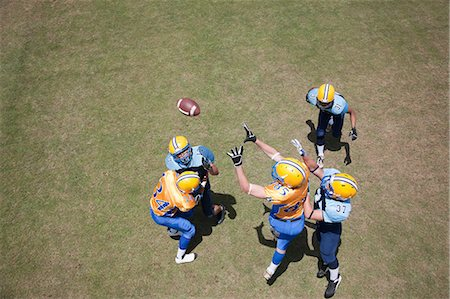 Football player playing football Stock Photo - Premium Royalty-Free, Code: 635-07521979